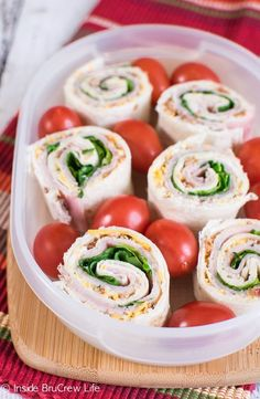 Meat and cheese is layered with a cheese spread and veggies for a fun pinwheel snack.