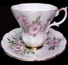 Royal Albert - Wild Rose  1950s to 1970s  Cup Shape: Countess, Lyric, Hampton, Smooth  Series of 12:  Carnation, Chrysanthemum, Cosmos, Daffodil, Gladiolus, Hawthorn, Larkspur, Morning Glory, Narcissus, Primrose, Sweet Pea, and Wild Rose