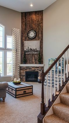 Rustic wood wall + stone fireplace. Fischer Homes