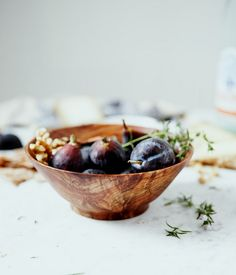 wooden bowl with plums