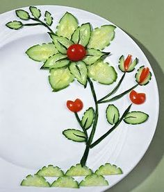 The W's: Food decoration art, Part 1 [not a recipe or tutorial] i think this is all various cut pieces of cucumber along with some cherry tomato