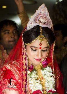 Expression of a bride during Mala badol