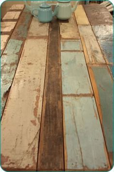 flooring ...reclaimed from old homes, with the original paint colors great table-- new one could be distressed and painted to look like this-ASCP