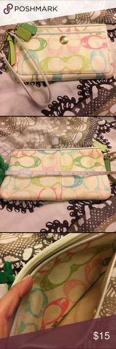 """Cute Coach wristlet Cute authentic coach wristlet with pastel colored C's print. Has been used and normal wear, and smudges, including some discoloration as pictured. Still has a lot of life left. Inside is fairly clean with a couple marks. Approximately 7.5"""" in length and 4.5"""" in height. Perfect for phones, cash and cards on the go! Coach Bags Clutches & Wristlets"""