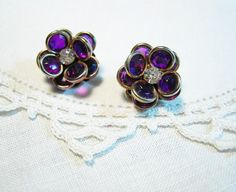 PURPLE FLOWER VINTAGE Clip Earrings Rhinestone Gold Tone Spring Fashion Bridesmaid Jewelry by SweetDaphneVintage on Etsy https://www.etsy.com/listing/178184660/purple-flower-vintage-clip-earrings