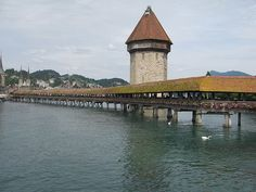 Lake Lucerne Bridge. Got to see it before the fire that almost destroyed it.