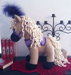 This is a CROCHET PATTERN and NOT the finished toy* Sandy is a lovely little pony ! You can crochet her with or without her circus kit ! She is so adorable ! This pattern have 12 pages with a lot of color pictures and many details to help you to crochet this projet very easily. Finished size: 15 inches tall by 13 inches long This pattern is in English and its an Instant digital download. You will receive a link after your purchase to download it. Your questions are welcome! ************...