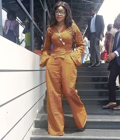 Ankara Jumpsuit is a must in every women's warddrobe.It gives you a stylist and trendy look.It can fit in every occassion whether its party or a formal look.jumpsuits suits on taller women than the short ones.It is very easy to carry and we can wear it an African Inspired Fashion, African Print Fashion, Africa Fashion, African Fashion Dresses, African Attire, African Wear, African Dress, African Women, African Jumpsuit