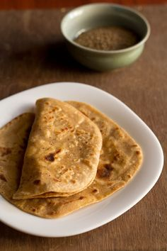 Paneer Paratha Recipe with step by step photos. Paneer Paratha is an Indian flatbread made with whole wheat flour and cottage cheese stuffing. Veg Recipes Of India, Indian Food Recipes, Gourmet Recipes, Vegan Recipes, Dinner Recipes, Cooking Recipes, Indian Foods, Cooking Ideas, Indian Flat Bread