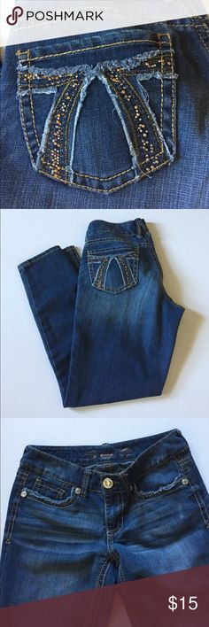 """Seven7 Distressed Stretch Jean Leggings Very good condition. Medium wash. Low rise, stretch. Slightly distressed. Threads on one side of coin pocket have pulled loose. Front zipper and button closure. Some of the back pocket decorations missing. Size 6. 77% cotton, 20% polyester, 3% spandex. Waist about 30"""", rise about 8"""", inseam 27.5"""". Not from a smoke free house. 312 Seven7 Pants Leggings"""