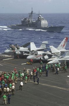 Pacific Ocean (Aug. 7, 2004) - Sailors assigned to the aircraft carrier USS Kitty Hawk (CV 63) conduct a foreign object debris (FOD) walkdown on the flight deck during a photo exercise with Kitty Hawk and the aircraft carrier USS John C. Stennis (CVN 74) carrier strike groups. The guided missile cruiser USS Chancellorsville (CG 62) sails alongside of Kitty Hawk. U.S. Navy photo by Photographers Mate 3rd Class Lamel J. Hinton (RELEASED)