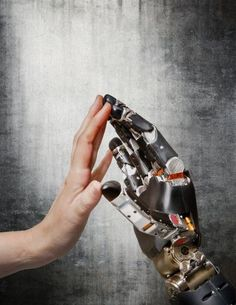 Restoring touch for amputees using a touch-sensitive prosthetic hand