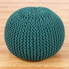 Our Mallard Green Knitted Pouf is a great alternative for extra seating in your home. To make each pouf, skilled artisans expertly knit richly-dyed yarn around an ultra plush cotton filling. The result is a sturdy yet incredibly comfortable place to sit for you and your guests that won't take up a lot of space, or a lot of your budget. In a convenient size, they're a great option for apartments, family rooms, and kids' rooms.