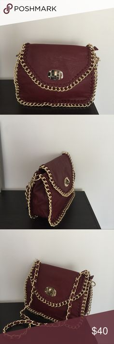 Maroon handbag with gold chain details Shoulder or cross body: whichever way you wear is going to be amazing. It has gold chain details all the way round and has a small pocket inside Miztique Bags Shoulder Bags