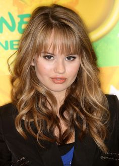 she makes me want bangs. and this hair in general.