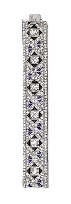 ART DECO DIAMOND, SAPPHIRE AND ONYX BRACELET, VAN CLEEF & ARPELS, PARIS, CIRCA 1930.  The articulated band decorated in an openwork geometric pattern, set at intervals with 6 old European-cut diamonds weighing approximately 10.00 carats, quartered by triangular onyxes, completed by approximately  360 old European-cut and single-cut diamonds weighing approximately 16.25 carats and decorated with calibré-cut sapphires, mounted in platinum, signed Van Cleef - Arpels, maker's mark, assay mark.