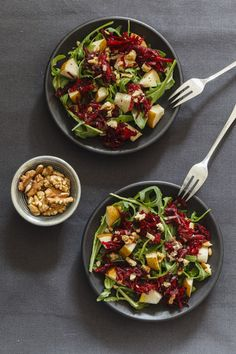 Two bowls of beetroot salad with rocket and walnuts stock photo - OFFSET