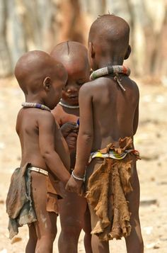 Africa | 'Let me tell you a secret'. Himba children. Namibia | ©Dror Yalon