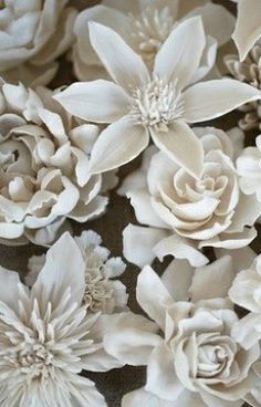 Use porcelain flowers to decorate a wall of a table, just for a bit of drama...! More
