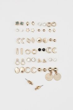 a82338c32 25 pairs Stud Earrings - Gold-colored - Ladies | H&M US 1 Family Jewels