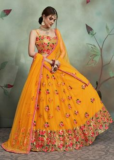 Mustard Yellow Net Designer Flared Lehenga Choli with Floral Embroidered Butta and Sequinsed Border Indian Fashion Dresses, Indian Bridal Outfits, Indian Gowns Dresses, Dress Indian Style, Wedding Outfits, Latest Wedding Dresses Indian, Indian Wedding Clothes, Designer Indian Dresses, Pakistani Clothing