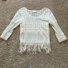 "NWOT SJS crochet lace top Crochet lace top. Paired over Bralet, tank or whatever meets your fancy. It is see through.  Fringe ends. 3/4 sleeve. Beige/cream/Ivory color.  20"" length not including fringe. Pit to pit laying flat is 18"" SJS Tops"