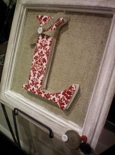 Picture frame, burlap, glue, letter and fabric...perfect! Going to try this