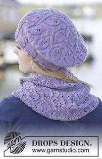 """Dancing Leaves - Set consists of: Knitted DROPS hat with cables and leaf pattern and knitted neck warmer with leaf pattern in """"Merino Extra Fine"""". - Free pattern by DROPS Design"""