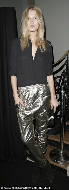 Going for gold! Toni put her own spin on combining delicate and gaudy textures at the Better High Party on Friday night, teaming a flimsy black blouse with gold PU trousers