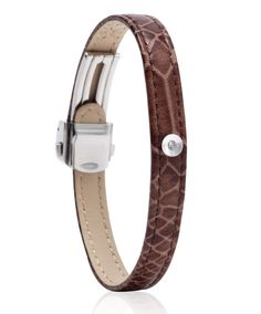 Beautiful for both Man & Woman!     3 points (0.03 Carat) perfect cut G VS1 natural Hearts & Arrows diamond mounted in Bezel setting.     Bracelet is made of genuine cuff leather in Brown Snake colour. Size of bracelet is self adjustable with unique buckle mechanism. We support three types of bracelet lengths, please choose the suitable for you.     Diamond setting is detachable, enabling you to easily switch bracelet colour and style. It is possible to buy additional bracelets without the…