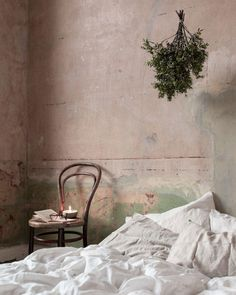 Old stripped bare plaster walls and white stonewashed linen bedding + instructions for how to properly care for linen bedding so it lasts for generations. Home Design, Interior Design, Room Interior, Design Ideas, Bedroom Wall, Bedroom Decor, Bedroom Ideas, Design Bedroom, Distressed Walls