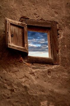 open window in a clay wall