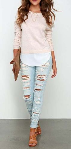 Ripped jeans and a pretty peach top for a breezy spring day.