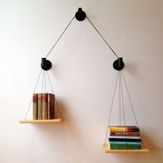 Weigh your reading options with a scale shelf. | 27 Insanely Clever Ways To Display Your Books