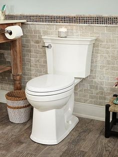 It looks like an ordinary toilet—until you lift the lid. In place of the traditional wash-down holes under the rim, a side-mount jet creates a vigorous, counterclockwise vortex of water that cleans the bowl two times better than those clog-prone holes. Each flush uses only 1.28 gallons but still achieves the highest score in tests of solid-waste removal. | VorMax high-efficiency toilet, by @amstandard