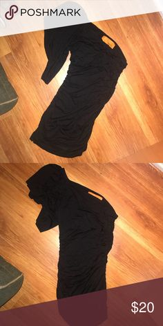 One shoulder black dress Cute one shoulder dress, picture doesn't do it justice but it's a skin tight black dress the sides are scrunched with one flowy sleeve can be dressed up for a classy look or club wear! Dresses Mini
