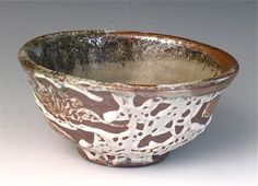 I am so impressed with this artist on esty. He uses carbon trapping and crawling shino glazes, that look great