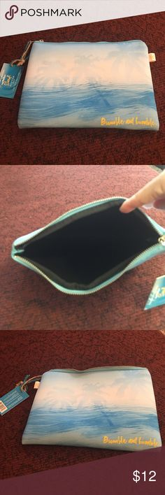 Bumble and bumble surf clutch  Seabreezy NEOPRENE clutch. Like new, never been used. Bumble and bumble  Bags Clutches & Wristlets