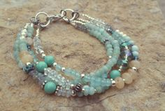 Check out this item in my Etsy shop https://www.etsy.com/listing/257502002/aquamarine-bracelet-larimar-bracelet