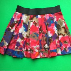 Jessica Simpson bright pleated floral skirt  Jessica Simpson skirt. Pleated skirt with black elastic waist band. Nice pockets hidden in side pleats. In good shape. No rips or stains. Size Small. Jessica Simpson Skirts