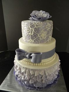 Adorable lavender and white wedding cake #wedding #weddingcake #cake #lavender #bow