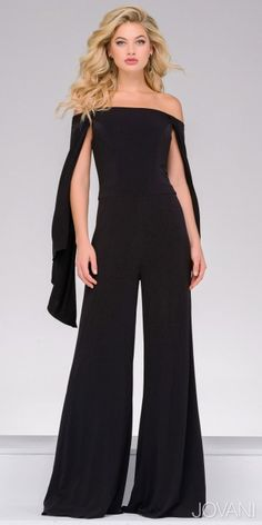 Leave the dress in the closet and opt for a unique look with the Off the Shoulder Wide Leg Jumpsuit by Jovani. This contemporary chic style features an off the shoulder neckline, long mock sleeves and a covered back with an invisible zipper down the center. This jumpsuit also includes jersey knit fabric, a fitted bodice and wide cut pant legs. #edressme