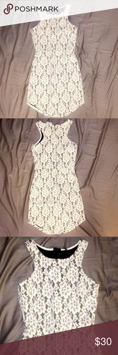 """Lace Dress Beautiful black dress with a white lace overlay! Comes up slightly on the sides,l & has the most perfect fit! Hugs all your curves & is incredibly flattering! (Brand is really """"Blanc"""" but listed as Lulu's for exposure!) Lulu's Dresses Mini"""