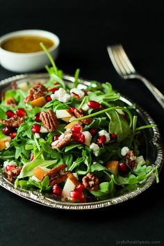 A fresh arugula salad topped with nutrient rich pomegranate seeds, pears, candied pecans, creamy goat cheese and a white balsamic vinaigrette.  I know that pomegranates have been a fad for a while now. They are tasty, packed with anti-oxidants, make you feel like you are eating something exotic which is always fun. I'm usually behind the ball on the 'fads,' with food and fashion. Luckily I eventually come around. I had thought about trying pomegranates for a while, but the price t...