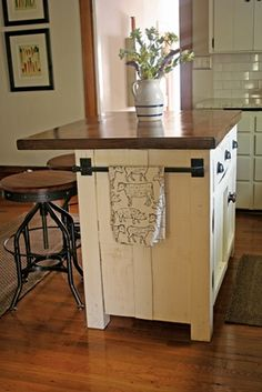 "DIY Kitchen Island - like this but with a detachable ""leaf"" on the other side too. Lockable wheels. Open shelves for laptop storage. Stools with backs."