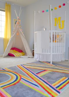 Playful and Bright Shared Nursery + Big Girl Room - how amazing is this PLAY rug?!