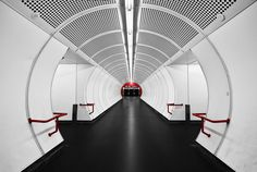 White tube with red dot by Ronny Huth