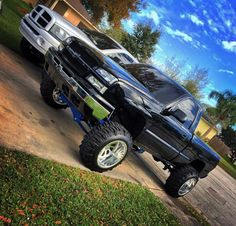 Lifted chevy single cab with blue lift kit