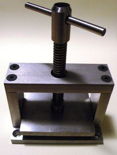 Oooh la la! Would love to have this miniature book binding press... hmmm wonder if I could put one together... Xx