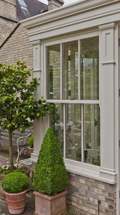 Garden room sunroom Fluted pilasters with recessed panels frame the sash window and exposed brick below to match original building Indoor Outdoor, Outdoor Living, Sash Windows, Windows And Doors, Orangerie Extension, Porches, Gazebo, Breezeway, House Extensions